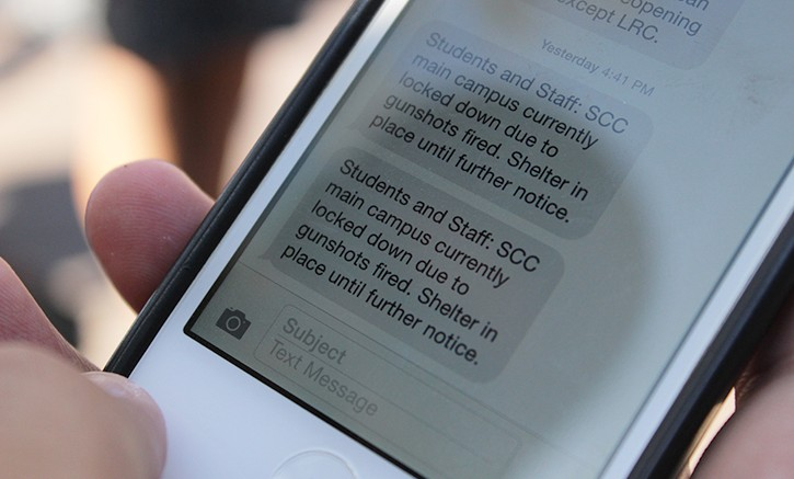 A Sacramento City College student's phone shows a time-stamped message from the district's emergency message system, run by WARN Command, coming 40 minutes after the fatal shooting that occurred on campus began on Sept. 3. The district is considering new options for which company to use for the ALERT system. (Photo by Barbara Harvey)