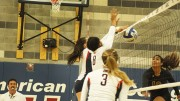 Sophomore middle blocker Erianna Williams, middle, and freshman outside hitter Candice Reynoso, left of Williams, block a spike attempt by Hartnell sophomore Neysha Laumatia. ARC won 3-2 and also won their second match of the doubleheader against Lassen College on Aug 28, 2015. (photo by Kameron Schmid)