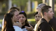 A police officer talks to Davida Trejo, the mother of shooting victim Roman Gonzalez, 25, on Thursday after the on campus shooting at Sacramento City College that left Gonzalez dead and two other students injured. (Photo by Ashlynn Johnson)