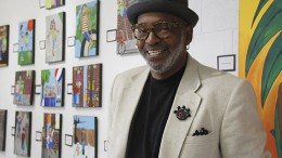 """Gerry Otis Simpson, also known as GOS"""", stands in front of his series """"Let The Children Play"""" at his studio on Del Paso Boulevard. Simpson, a former ARC visual merchandising professor, hopes that his gallery will reinvigorate the Del Paso art community, which has declined in recent years. (Photo by Barbara Harvey)"""