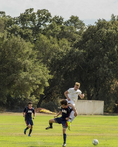 Two players fight for the possession of the ball in ARC's season opening loss to Feather River College. ARC had control of the ball more frequently throughout the match but did not score, losing 1-0. (Photo by Joe Padilla)