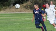 American River College forward Hector Zavala, left, moves the ball downfield during ARC's 1-0 loss to Feather River College on Aug. 28, 2015. FRC scored the only goal of the game early in the first half. (Photo by Joe Padilla)