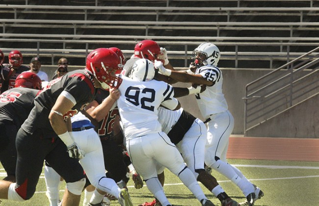 American River College Players collide with players from City College of San Francisco during the game on Sat. Sept. 26 at CCSF.  ARC won against CCSF 20-17. (Photo By Ashlynn Johnson)