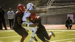 American River College's quarterback Jihad Vercher getting tackled by Community College of San Francisco players Rod Jones and Austin Larkin during a game at CCSF on Sept. 26, 2015. (Photo by Ashlynn Johnson)