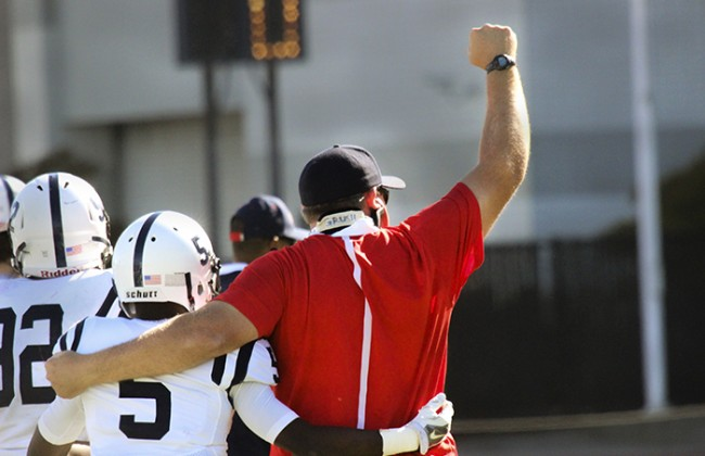 American River College Offensive Coordinator Doug Grush celebrates with ARC wide receiver Tim Johnson after a 20-17 win against City College of San Francisco on Saturday Sept. 26. (Photo by Ashlynn Johnson)