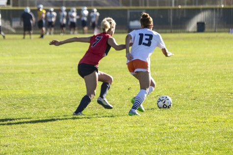 Savannah Watson of American River College and Breona Robinzine of Cosumnes River College go after the ball during their match at ARC on Oct 16.  (Photo by Joe Padilla)