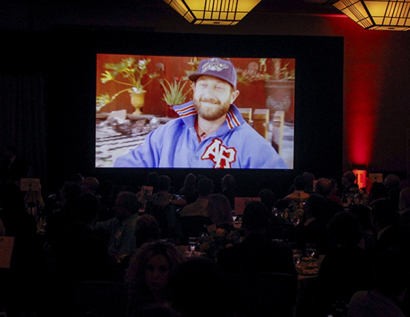 Attendees of the Los Rios Foundation Honors and Awards Gala watch a video featuring Dallas Braden, a former player for the Oakland Athletics and American River College alumnus. Braden was a guest at the gala where he was one of four alumni honored by the foundation on the occasion of the Los Rios district's 50th anniversary. (Photo by John Ferrannini)