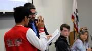 Sen. Kevin Phan, left, is sworn into the Student Senate at Thursday's meeting by David Hylton, who is acting as Senate president following the unexpected resignation of Garrett Kegel. (Photo by Joseph Daniels)