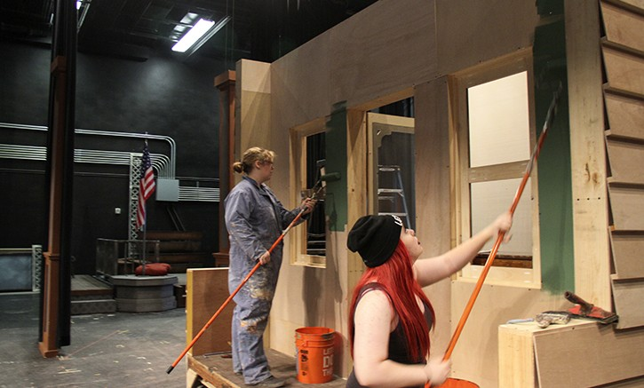 """American River College students Alice Morgan, left, and Kori Einsel build the sets for the upcoming theater production of """"Music Man."""" That production will open on Oct. 9. (Photo by Ashlynn Johnson)"""