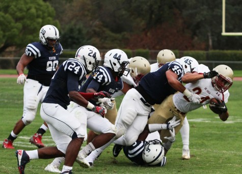American River College defensive lineman Anthony Luke tackles De Anza College running back Trevon Harris during ARC's 38-2 win against De Anza College during the home opener on Sept. 12, 2015. ARC's defense shut out De Anza offense, holding them to just 42 total rushing yards. (Photo by Barbara Harvey)