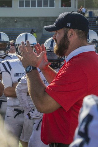 American River College head coach Jon Osterhout gives his team a pep talk after their game at College of San Mateo on Oct. 3. The AR Beavers lost the game 42 to 10. (photo by Joe Padilla)