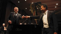 Award-winning pianist Jon Nakamatsu, right, gives a pen back to American River College Orchestra director Steven Thompson in the ARC Theater on Oct. 30, 2015. Nakamatsu was invited to sign the grand piano after performing with the orchestra. (Photo by John Ferrannini)