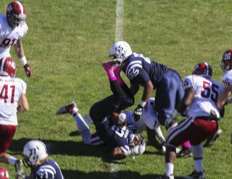 American River College's running back Ce'von Mitchell-Ford gets upended by Sierra college's Jeff Williams II during their game on Oct 31 at ARC. The Beavers won the game forty-seven to twenty-two. (Photo by Joe Padilla)