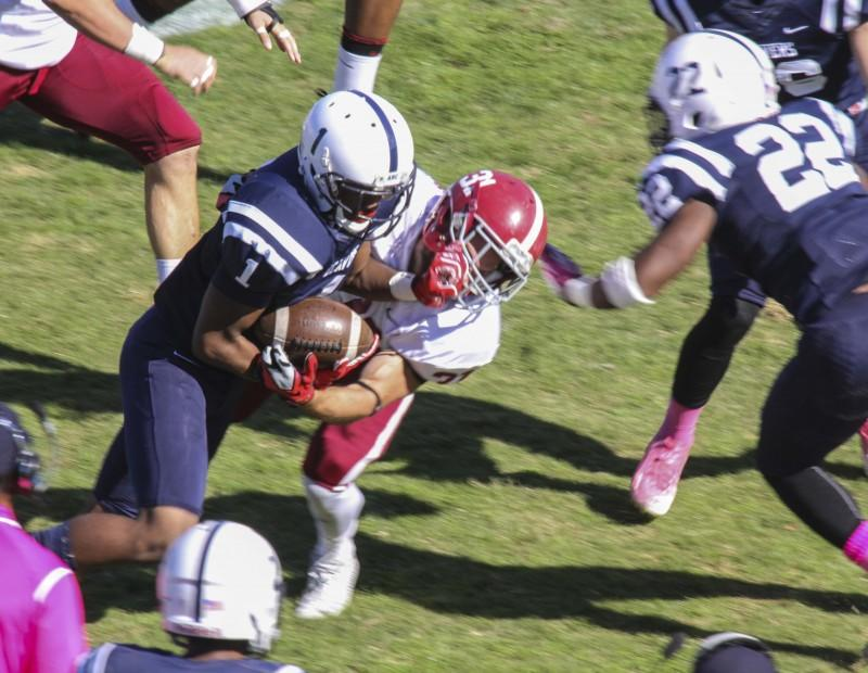American River College's Khalil Hudson drives through a tackle from Sierra College's Andrew Lackowski during their game on Oct 31 at ARC. The Beavers won the game forty-seven to twenty-two. (Photo by Joe Padilla)