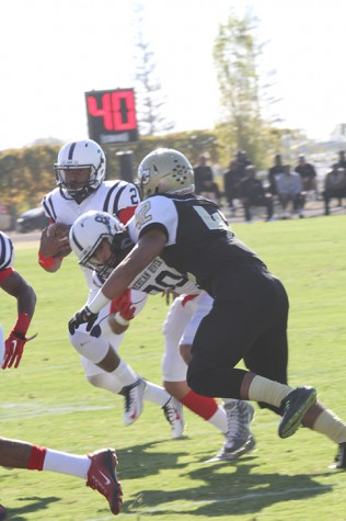 American River College quarterback Jihad Vercher dashes behind a block set by wide receiver Marc Ellis. Vercher finished the game 18 of 31 for 307 yards passing while Ellis had 72 yards on three catches, including a 38-yard touchdown. (Photo by Nicholas Corey)