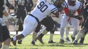 Defensive lineman Nick Terry and the rest American River College's defense converges on a ball carrier for Butte on Nov. 7, 2015. Terry racked up 5 total tackles, one of which was for a 3-yard loss in the 27-24 defeat. (Photo by Nicholas Corey)
