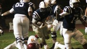 Running back Armand Shyne for American River College bursts through a wall of Sacramento City College defenders. Shyne ran for two touchdowns with over 120 yards on the ground in ARC's 38-18 win on Nov. 14, 2015. (Photo by Nicholas Corey)