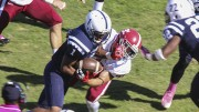American River College's Khalil Hudson drives through a tackle from Sierra College's Andrew Lackowski during last Saturday's game at ARC. ARC plays Butte College this Saturday (Photo by Joe Padilla).
