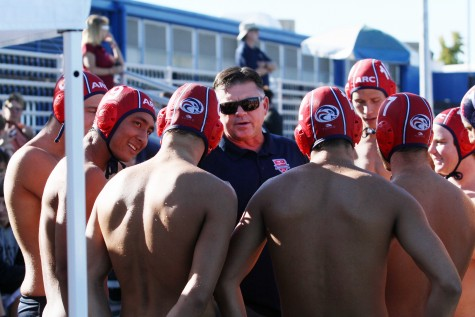 American River College coach Eric Black gathers the water polo team around as he breaks down Sierra's defense. ARC fell to Sierra by a score of 4-3 on October 21, 2015. (Photo by Nicholas Corey)