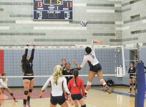ARC player Erianna Williams gets up high to return the ball in a playoff win Tuesday night against City College of San Francisco at ARC. (Photo by Johnnie Heard)