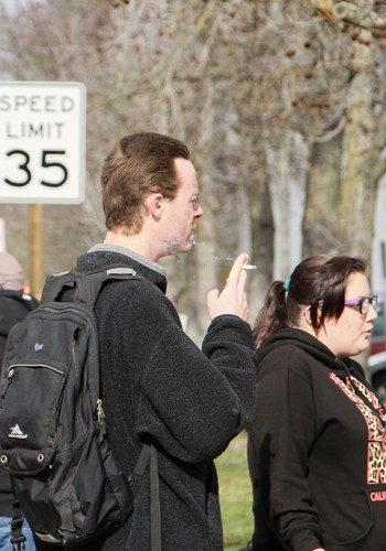 American River College students are forced to smoke at the bus stop, due to to new campus ban on smoking that went into effect on Jan. 1. (Photo By Kyle Elsasser)