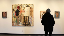 An American River College student looks at the work of Jack Ogden on display at the James Kaneko Gallery at ARC. The display is up form Jan. 14 to Feb. 10. (Photo by Timon Barkley)