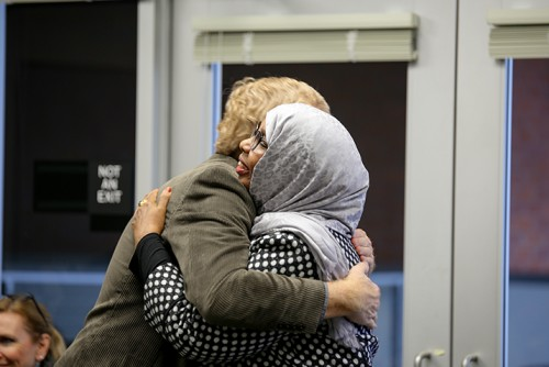 English professor John Hess (left) hugs former student turned teacher Faryal A. Said after Said received an award. Deserving teachers were presented with an award Thursday that was voted on by students at American River College. (Photo by Kyle Elsasser)