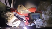 Fronius technical sales engineer Fritz Arumber welds together some metal during the Welding Expo at American River College on Feb.6, 2016. The welding industry has been looking for welders and the expo was held to offer apprenticeships and jobs. (Photo by Matthew Nobert)
