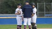 American River College pitching coach Preston Vancil talks with starting pitcher Andrew Wiesenfarth and catcher Matt Elliot in Saturday's 12-11 loss to West Valley College. Wiesenfarth walked 6 batters and took a no decision in the loss for ARC. (Photo by Joe Padilla)