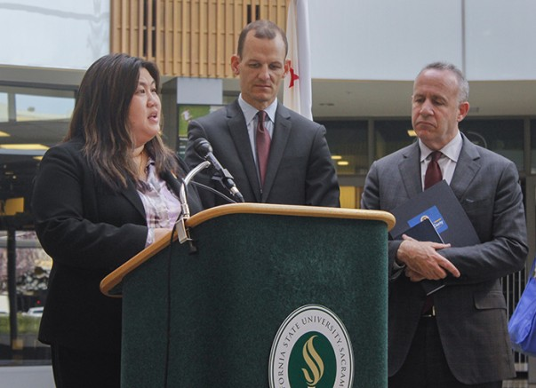Sacramento City College professor Belinda Lum (left) speaks at a press conference announcing Assembly Bill 2017 at Sacramento State University in Sacramento, California on Feb. 25, 2016 as former California State Senator Darrell Steinberg (right) and California State Assemblyman Kevin McCarty (center) watch. The bill will help fund mental health services on community college campuses across the state. (Photo by Hannah Darden)