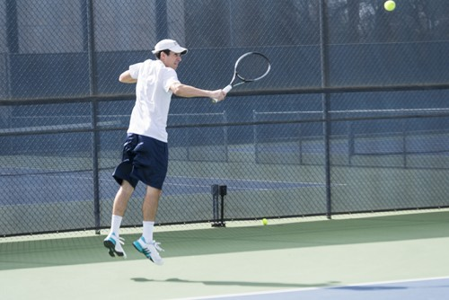 Seppi Capaul returns a serve during American River College's tennis match with Folsom Lake College at AR on Feb. 20, 2016. The Beavers won the match 9 to 0. (Phot by Joe Padilla)
