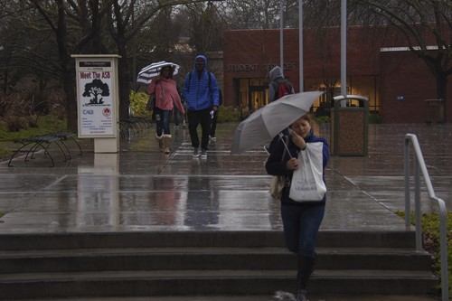 Returning Student find a rainy day to greet them as they make their way to Student Services. This years El Nino will help with the drought in California but it wont solve it. (PhotoTracy Mapes)