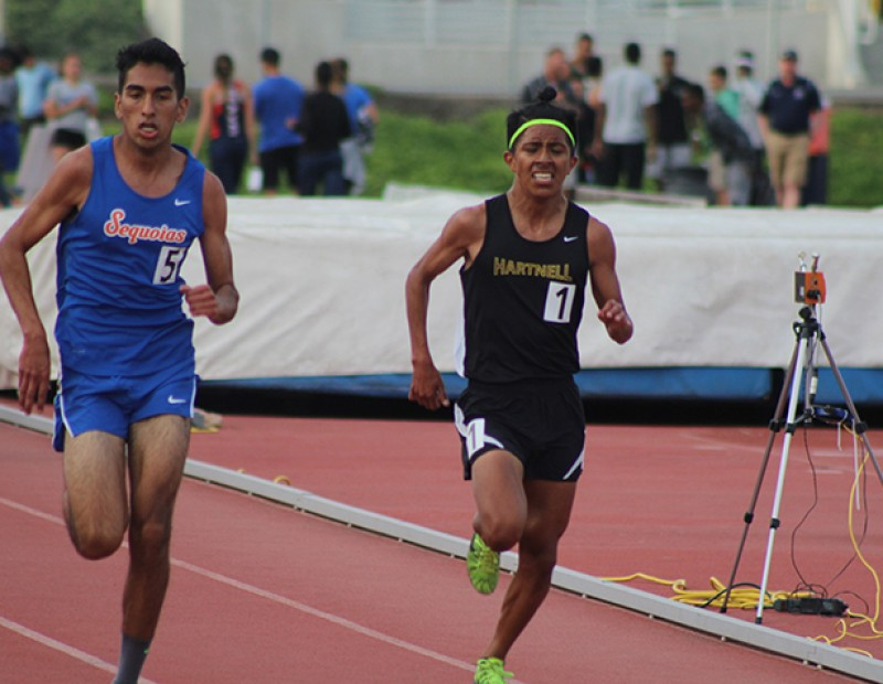 Adam Gonzalez of Sequoias (left) chases down Jorge Sanchez of Hartnell College (right) before the finish line of the men's 5000m race at the American River Invitational on March 26, 2016 at American River College. Gonzalez won the race with a time of 15:36.18, beating Sanchez by 57 hundreths of a second. (Photo by Mack Ervin III)