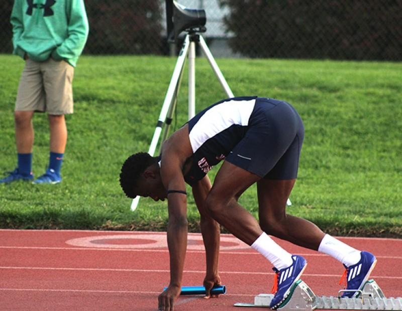American River College sprinter Isaiah Griffin prepares to break from the blocks for the men's 4×400 relay at the American River Invitational on March 26, 2016 at ARC. Griffin and the ARC team finished 3rd with a time of 3:15.36. (Photo by Mack Ervin III)