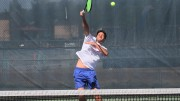 American River College men's tennis player TJ Aukland jumps up to return the ball during practice on Mar. 30, 2016 at ARC. The team will be traveling to Santa Rosa this Thursday for the BIG 8 North Conference Tournament. (Photo by Matthew Nobert)