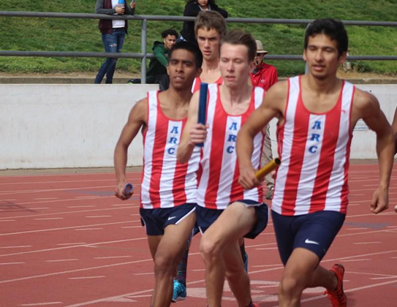American River College runners completing their leg of the men's distance medley during the 31st annual Beaver Relays on March 4, 2016 at ARC. ARC teams finsished 1st, 2nd, 4th, and 5th in the event. (Photo by Matthew Nobert)