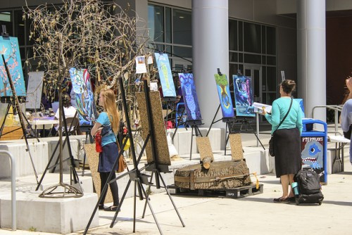 Art panels made from old trash cans by art department students were displayed during the Earth Day  celebration on April 19 and 20. (Photo By itzin Alpizar).
