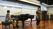 Vocal student Marissa DeBarge, right, sings in front of the special guest Lee Hoffman to receive feedback to be a better performer. The voice workshop wast hosted by ARC adjunct professor of music Catherine Fagiolo, left, at the music department on April 14,  2016 (Photo by Itzin Alpizar).