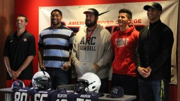 From left to right: wide receiver Marc Ellis, offensive lineman Max Harrison, head coach Jon Osterhout, wide receiver Jonathan Lopez, and linebacker Jordan Kunaszyk pose for a picture during a signing day event on April 1, 2016 at American River College. The four players committed to four-year universities following the 2015 season. (Photo by Mack Ervin III)