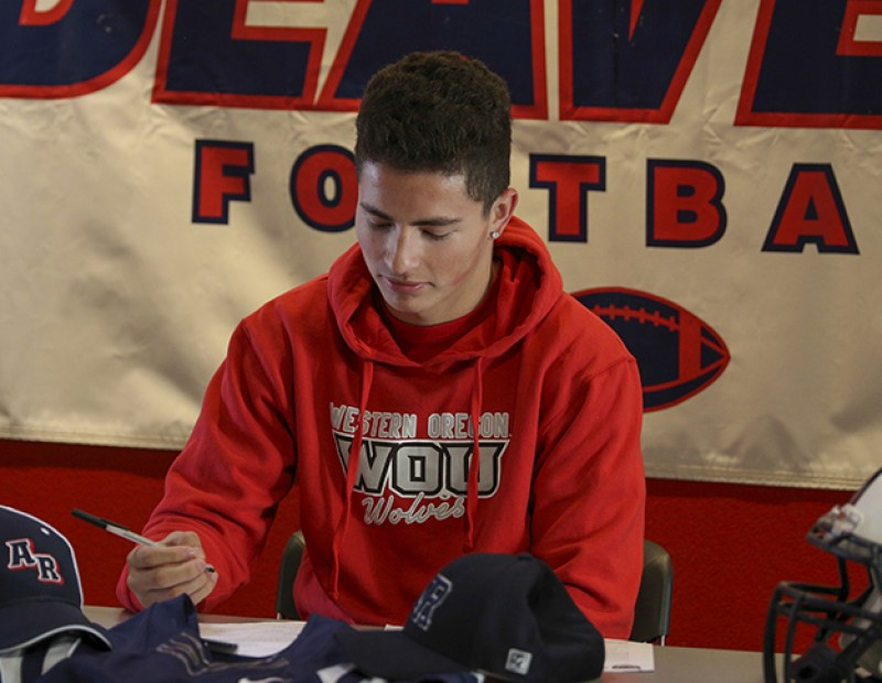 Jonathan Lopez signs his letter of intent to play football at Western Oregon on April 1 2016 at American River College. Lopez caught 36 passes for 540 yards and 6 touchdowns for the beavers in 2015. (Photo by Kyle Elsasser)