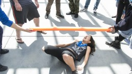American River College student Angelica DeGuzman went low during the limbo competition at Club day near the book store on April 14, 2016. Club day rules allows the person to touch the ground as long as their hands don't touch the ground. (Photo by Joe Padilla)
