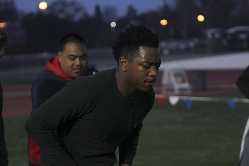 Defensive back Sammy Gray participates in a drill during an off-season conditioning class while linebacker coach Sid Robertson looks on. Robertson, along with all the assistant coaches, volunteers his time during the off-season. (Photo by Matthew Peirson)