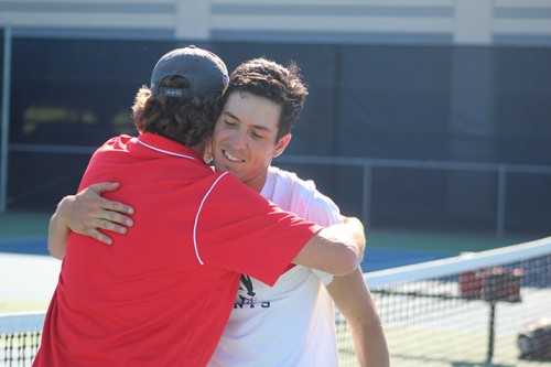 American River College men's tennis coach Bo Jabery-Madison hugs Seppi Capaul after his match against Jacob Strabo of Foothill College on April 16, 2016 at ARC. Capaul won his match 6-3, 6-1 to make ARC NorCal Champions. (Photo by Mack Ervin III)