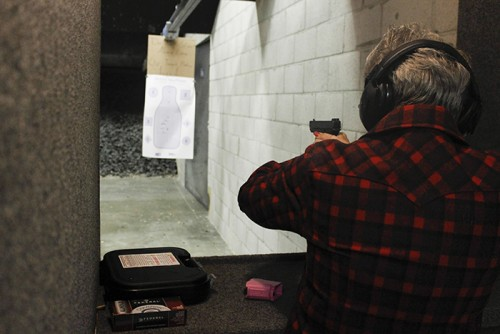 Well-Armed Woman member, Julie Gilchrist, shoots at a target at The Gun Range in Sacramento after her meeting on March 8. The women had discussed gun safety and responsibility. (Photo by Sharriyona Platt)
