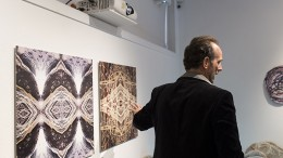 """Anthony Maki Gill describes his digital ceramic hybrid prints to audience members at the """"Explicit Material"""" gallery. Maki Gill's artwork was located in the Kaneko Gallery at American River College in Sacramento, California until April 14, 2016. (Photo by Kyle Elsasser)"""
