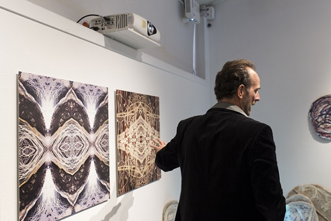 "Anthony Maki Gill describes his digital ceramic hybrid prints to audience members at the ""Explicit Material"" gallery. Maki Gill's artwork was located in the Kaneko Gallery at American River College in Sacramento, California until April 14, 2016. (Photo by Kyle Elsasser)"