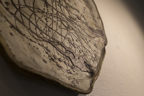 """A detail shot of of Anthony Maki Gill's ceramic porcelain painting titled """"Iron Lines."""" Maki Gill's artwork is located in the Kaneko Gallery at American River College in Sacramento, California. April 14 2016. (Photo by Kyle Elsasser)"""