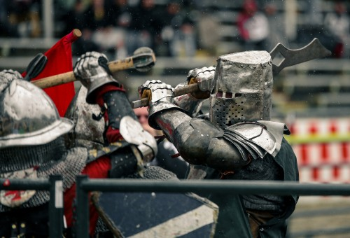 """The Northwest region """"WolfPack"""" battles with the USA Knights during the Armoed Combat League U.S. national championship held at the Auburn Fairgrounds on Mar. 5. The USA Knights are a U.S. all-star team and are set to compete in the world championships on May 26. (Photo by Kyle Elsasser)"""