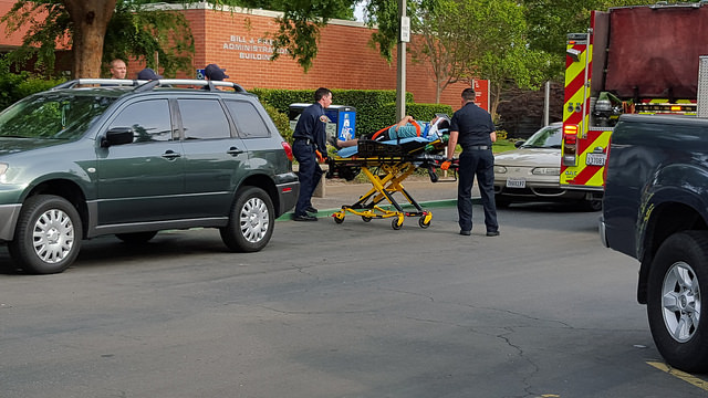 An American River College student involved in a physical altercation on Wednesday is transported by way of a stretcher to an ambulance in front of the administration building at ARC. Both students involved in the altercation declined to press charges. (Photo by Matthew Peirson)