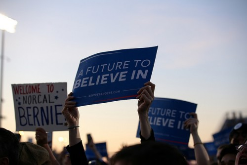 A member of the audience holds a sign that reads 'A Future To Believe In' during Bernie Sanders rally at Bonney Field in Sacramento, California on May 9, 2016. The rally drew a crowd of approximately 15,000 people. (Photo by Kyle Elsasser)